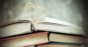 Image of books with pages folded into a heart
