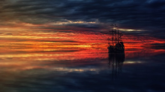 Photo of pirate ship at sunset