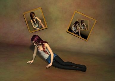 Teen sitting on floor with self portraits on wall