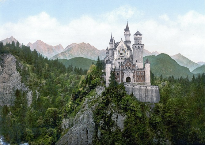 a mountaintop castle surrounded by forest