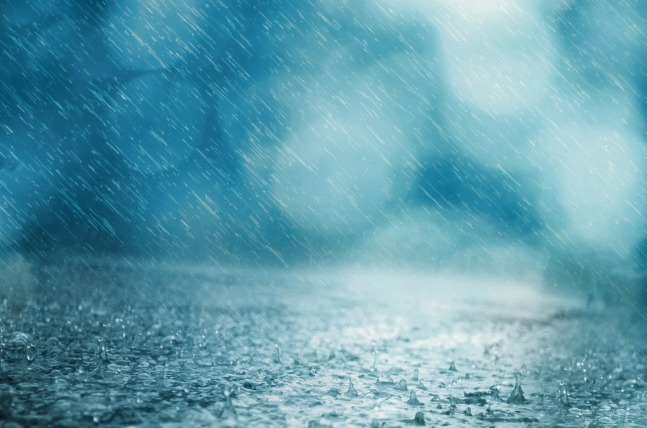 a heavy rain falling on a water-covered surface