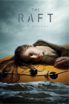 girl lying on life raft in the ocean