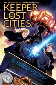 """Book cover for """"Keeper of the Lost Cities."""" A young woman and a young man are clinging onto either side of the top of a metal tower, which is topped by a lit lamp."""