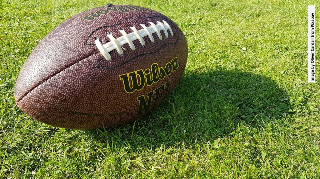 Image of a football on grass
